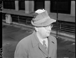 Man with miniature radio, Nov 1950